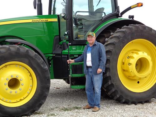 Farmer Wayne Erickson, now 83, and his current tractor. (NRCS photo)