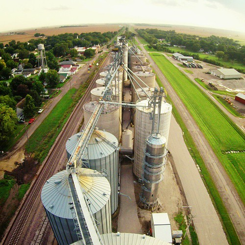Grain elevators at Elkhart, Illinois. On our way to our friends' (@jolodrake and @draketect) farm, a flash of rain saturated the soil. As we attempted to park the airstream on a patch of grass, we nearly got stuck as the tires dug deep trenches in thei
