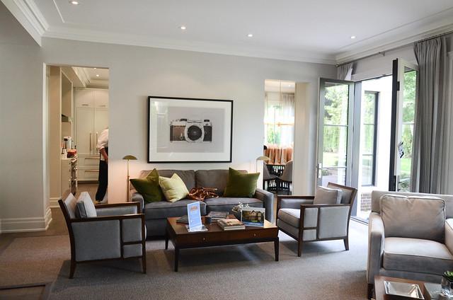 Cozy modern gray family room. Princess Margaret Showhome in Oakville