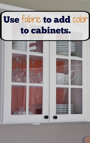 Add colored fabric to the backs of cabinets with glass doors