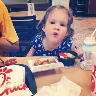 Next stop: Chick-fil-A! The Peppa Pig books they're giving out right now totally won Claire over.