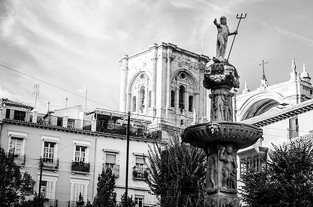 A statue of Neptune welcomes visitors to Granada's Plaza Bib-Rambla near the city's grand Cathedral.