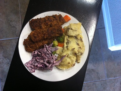 Steak fingers, cole slaw, veggies, and mashed potatoes.