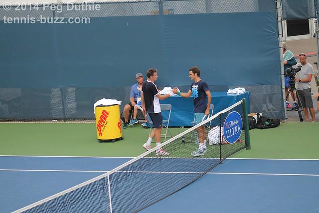Mahut-Federer handshake