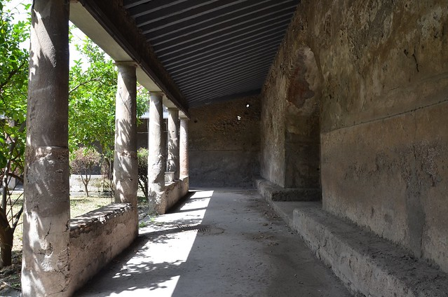 Forum Baths, the north portico supported by columns and stone benches, Pompeii