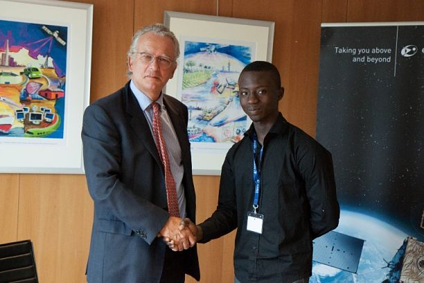 Lloyd Ossei Baffour DStv Eutelsat Star Awards poster winner 2013 with Michel de Rosen