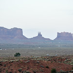 RV and cars leaving Monument Valley