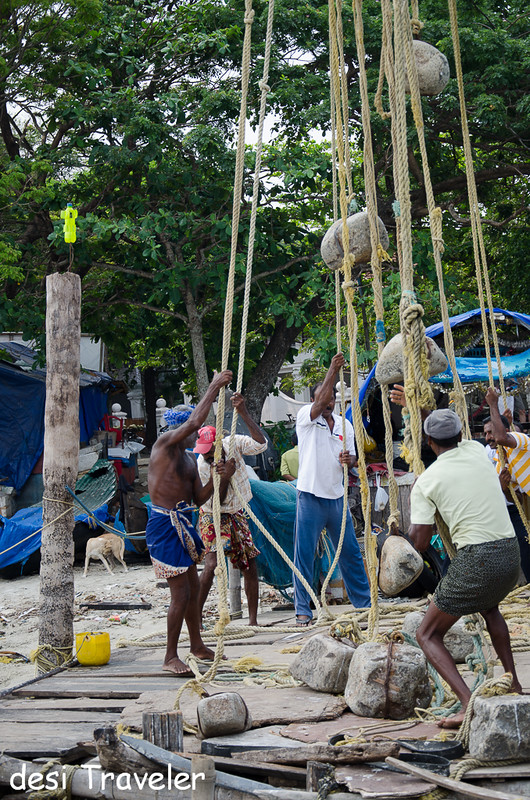 Fishermen working on chinese fishing net fort kochi