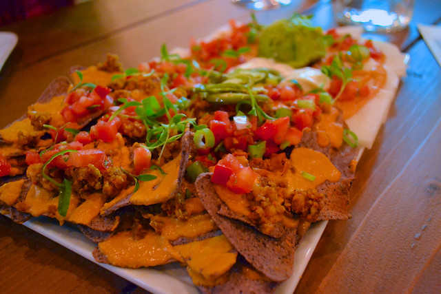 sun cafe nachos raw baked blue corn chips side