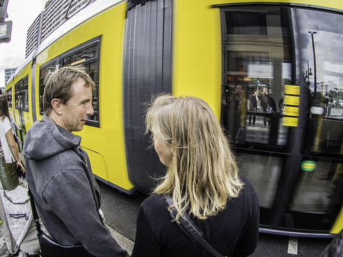 Man and Woman in front of Tram