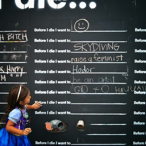 "As we walked by the 'Before I Die..."" art project wall, the girls stopped, asked a million questions and laughed at some of the responses filled in by others. Apparently ""Before I die I want to... not die"" was the most hysterical thing ever. Then without"