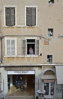 Girl On The Phone in The Window. Croatia  Nikon D3100. DSC_0034.