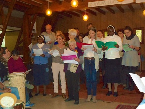 The central choir of the Deanary in Étampes singing Christmas Carols, with Gladys Ekhareafo SSL in the front row to the left and Mary Jo Abba SSL in the right of the picture