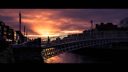 liffey color bridge cinematic street water person city hapenny sun urban sunset streetphotography ireland relflection sky hapennybridge europe dublin figure countydublin ie onsale faceless