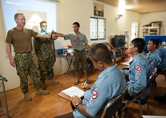 Capt. Kirk Eichenmuller and Hospital Corpsman 2nd Class Marvin Galapin teach basic life support techniques to Cambodian deminers. (U.S. Navy/MC2 Karolina A. Oseguera)