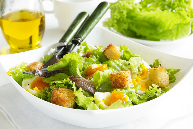 Salad with croutons, anchovies and eggs.