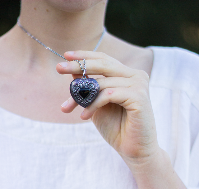 black and silver heart locket