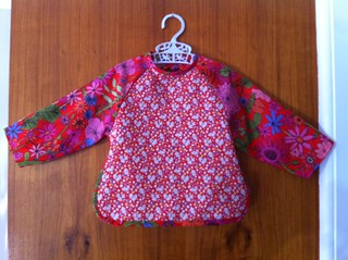 Enid Gilchrist feeder for infant- body in quilting cotton and sleeves in Liberty lawn (pattern 40s-60s)