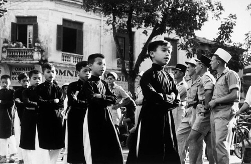 HANOI 1954 - Members of the French Foreign Legion watching children cross the street. 23 May 1954