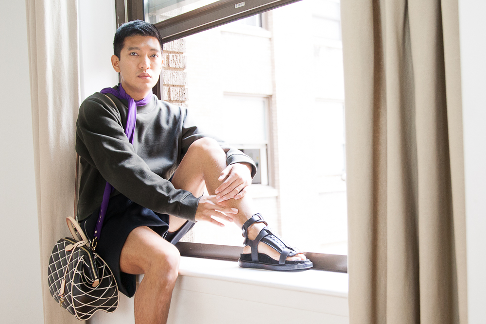 Bryanboy carrying a Louis Vuitton Malletage Doc PM bag