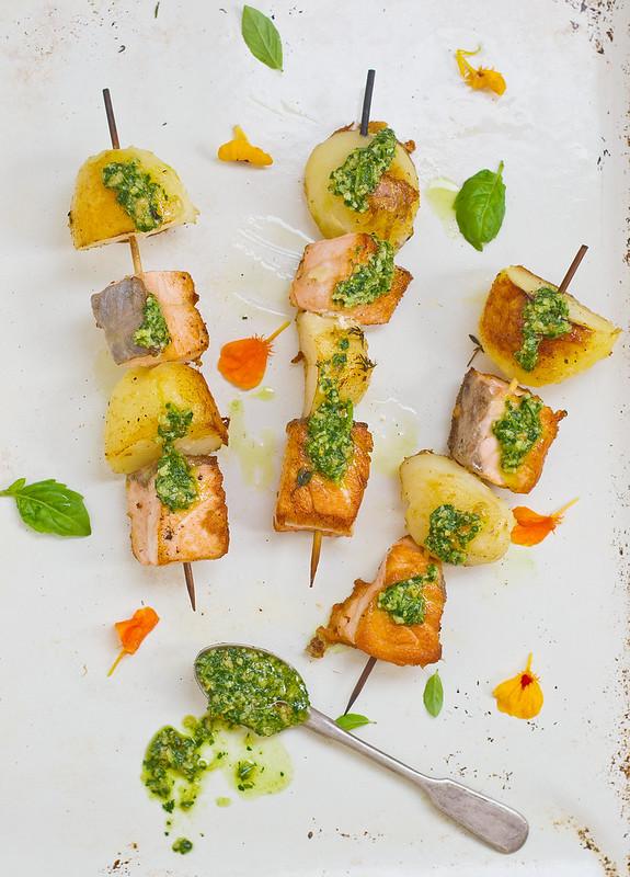 salmon and potatoes on sticks with pesto sauce.3