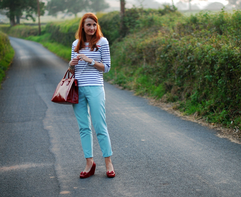 Breton stripes, mint trousers, red accents
