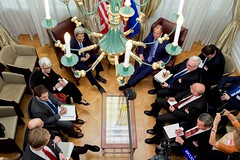 U.S. Secretary of State John Kerry - seen through a hotel chandelier - and his advisers sit with Russian Foreign Minister Sergey Lavrov and their counterparts on June 30, 2015, in Vienna, Austria, before a bilateral meeting amid P5+1 negotiations with Iranian leaders about the future of their nuclear program. [State Department photo/ Public Domain]