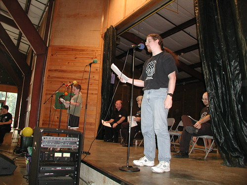 Phil Carter and Colin Butler perform as the rest of the cast looks on.