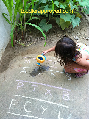 Watering an Alphabet Garden (Photo from Toddler Approved)