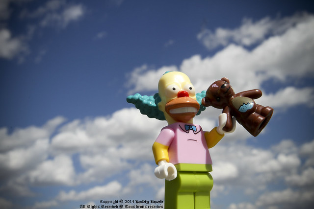 Oh no, Krusty the Clown steals Maggie Simpson's teddy bear to show off