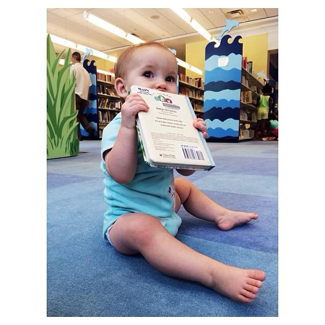 Even Mabry enjoyed the library today! #mabrymaeeveryday #everythinginthemouth #nowondershehasthrush