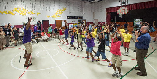 Baltimore Ravens football player Chris Canty leads children at Hamilton Elementary and Middle School through some fun physical activities