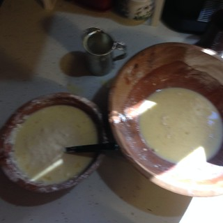 egg and flour mixing in wooden bowls