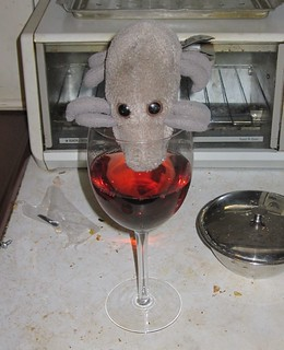 Dust Mite has a glass of wine