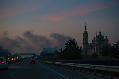road sunset sky church architecture fire evening smoke ukraine throughcarwindow lvivoblast solonka