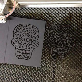 Taking a break from customer orders to laser-cut more skull cards in preparation for Halloween. #diadelosmuertos #backinstock