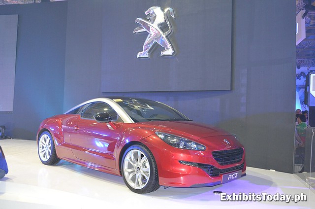 red Peugeot RCZ car