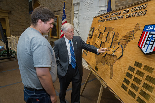 Daniel Stevenson, carpentry student of the Collbran Job Corps Center shows Tom Tidwell, Chief, U.S. Forest Service a map he created of the 28 Job Corps Centers in the United States at the 50th Anniversary of the Job Corp Civilian Conservation Centers celebration at the United States Department of Agriculture in Washington, DC, Wed. Sept. 17, 2014. The U.S. Forest Service operates the Job Corps Civilian Conservation Corps, the Nation's largest residential, educational and career technical training program for young Americans. USDA photo by Bob Nichols.
