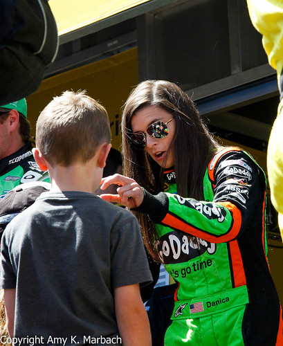 Danica Patrick interacts with a young fan