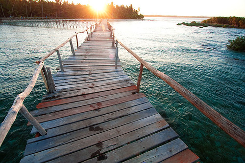 Beach sunset at the Cloud 9 surf pier in Siargao, Philippines