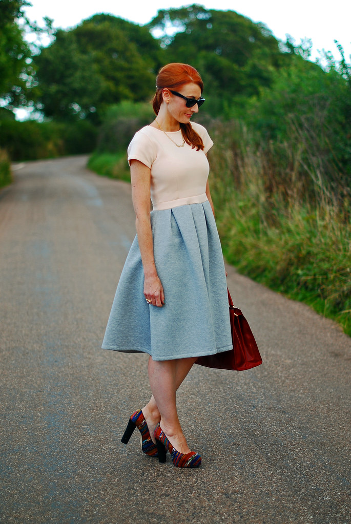 Two-tone full skirted dress and red tote