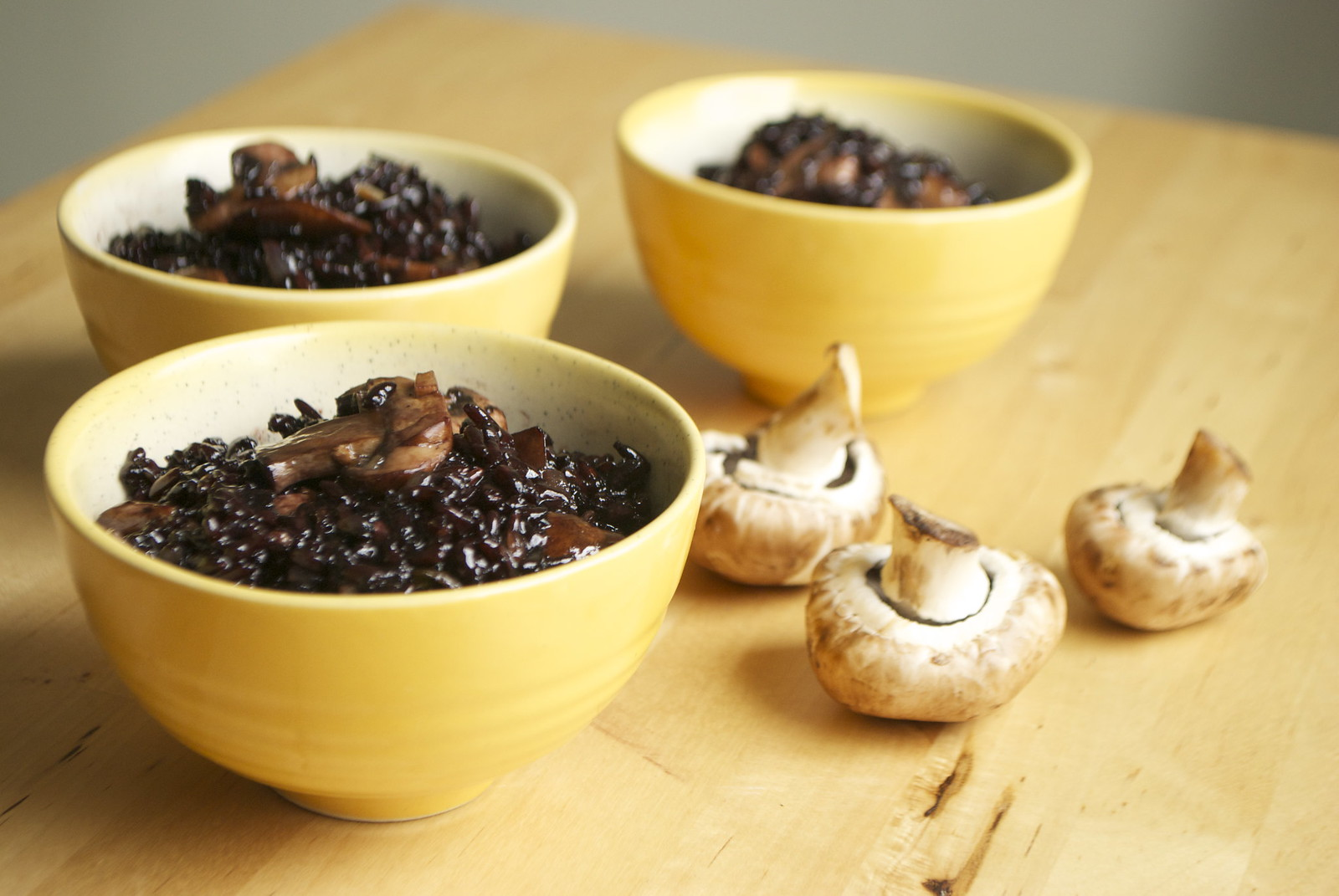 mushroom fried black rice, in bowls