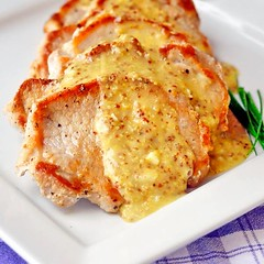 Pan Seared Pork Chops with Dijon Butter Sauce - simple pan seared pork chops served with a very quick, easy to make Dijon butter pan sauce. An easy but impressive weekday meal in 30 minutes or less. http://buff.ly/1vQBakO