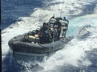A Coast Guard Law Enforcement Detachment transports 576 kilograms of cocaine, valued at $19 million, in the Straits of Florida, Aug. 21, 2014. The contraband was interdicted during Operation Martillo, a joint interagency and multi-national collaborative effort among 14 Western Hemisphere and European nations to stop the flow of illicit cargo by Transnational Criminal Organizations. (U.S. Coast Guard photo by Master Chief Petty Officer Sean C. Benton)