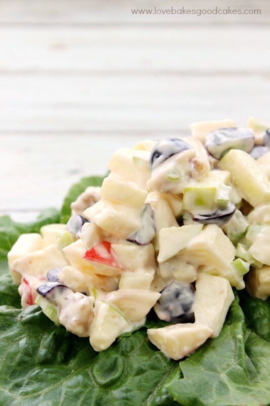 Traditional Waldorf Salad is full of fresh apples, celery, grapes and walnuts in a mayonnaise dressing. Serve it as a side dish or appetizer. You can easily add chicken or turkey to make it a complete meal! #CAwalnuts #salad #fruit