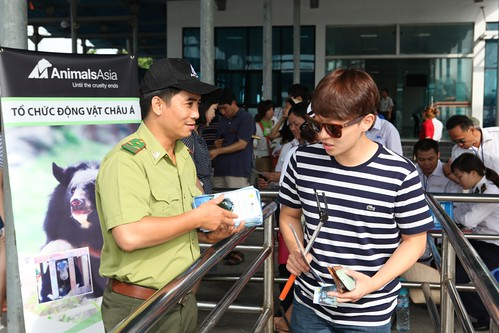 Forest Protection Department (FPD) staff hand out brochures to Korean tourists