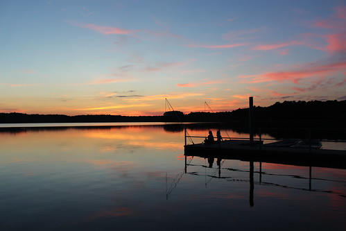 sunset reflections northcarolina lakecrabtree labordayweekend partlycloudy