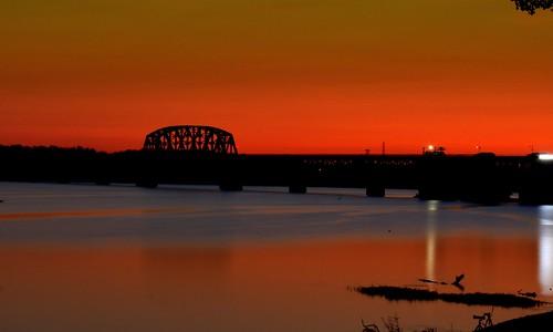 railroad bridge sunset sky water night river indiana southernindiana railroadbridge clarksville ohioriver