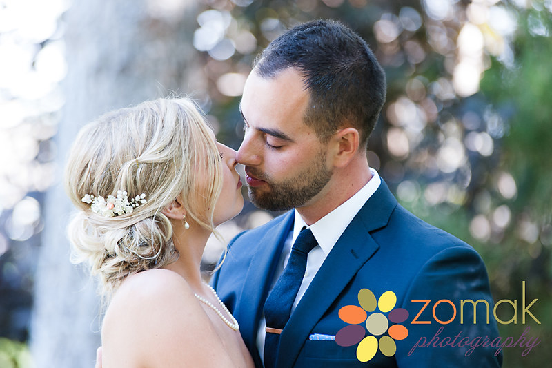 the bride and groom embrace in a romantic moment during their first look.