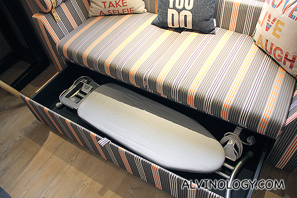 Look, there's an ironing board and iron, cleverly hidden in the sofa